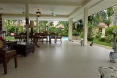 House For Sale Pattaya showing the inside outside living concept