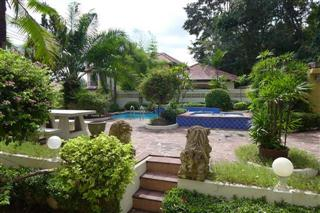 House For Sale Pattaya showing the pool side garden area