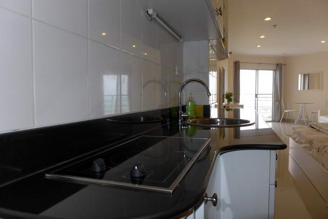 Condominium For Sale Jomtien showing the kitchen and dining areas