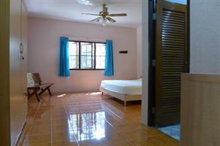 House for sale Pattaya showing the master bedroom with en suite bathroom