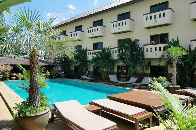 Serviced Apartments For Sale Pattaya showing the building and pool