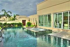 Pool villa for sale in Pattaya at The Vineyard Phase 2 showing the house and pool