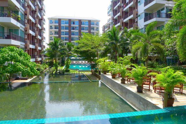 Condominium For Sale South Pattaya showing the communal pool and buildings