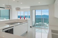 Condominium for sale Pratumnak Pattaya showing the kitchen area and balcony