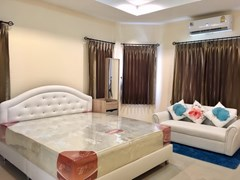House For Rent Pattaya showing the master bedroom with lounge area