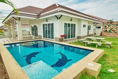 House for sale Bangsaray Pattaya showing the house, pool and garden