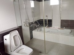 House for sale Bangsaray Pattaya showing the  master bathroom with bath tub