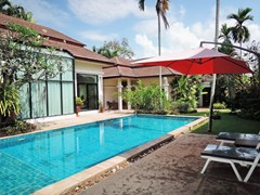 House for sale Pattaya showing the swimming pool and terraces