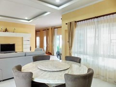 House for sale WongAmat Pattaya showing the living and dining area with garden view