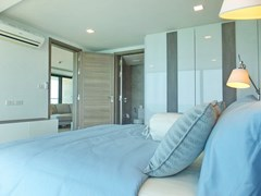 Condominium for sale Na Jomtien showing the bedroom and furniture