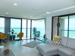 Condominium for sale Na Jomtien showing the living and dining areas and balconies