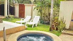 House for rent Jomtien Pattaya showing the pool Jacuzzi and garden
