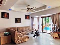 House for sale South Pattaya showing the living room poolside