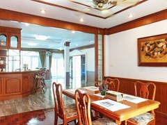 House for Sale Mabprachan Pattaya showing the dining and kitchen areas