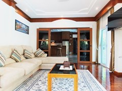 House for Sale Mabprachan Pattaya showing the living and kitchen areas