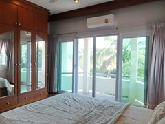 House for Sale Mabprachan Pattaya showing the second bedroom with built-in wardrobes