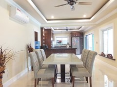 House for sale Nongpalai Pattaya showing the dining and kitchen areas