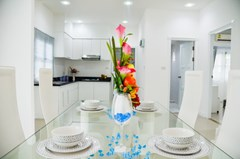 House for sale Pattaya showing the dining area, kitchen and second bathroom