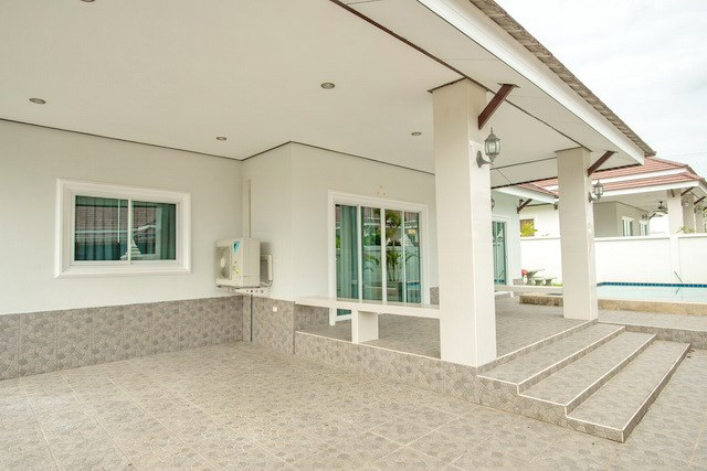 House for sale Bangsaray Pattaya showing the house and carport
