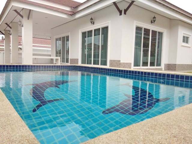 House for sale Bangsaray Pattaya showing the covered terrace and pool