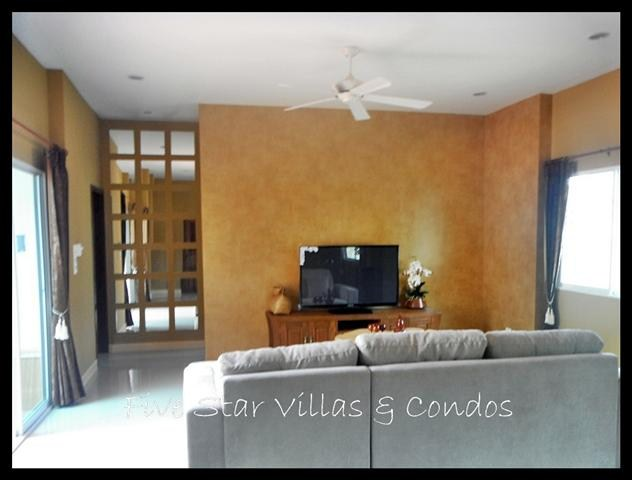 House for sale East Pattaya showing the sitting area and TV