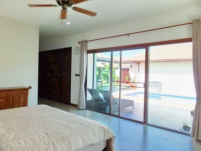 House For Sale Huay Yai Pattaya showing the master bedroom and built-in wardrobes