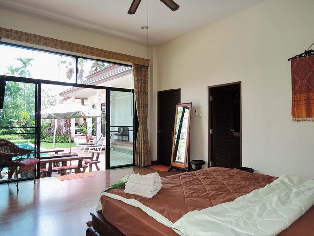 House for sale Pattaya showing the master bedroom suite poolside