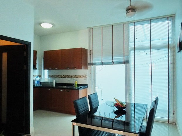 House for sale East Pattaya showing the dining, kitchen and outside utility areas
