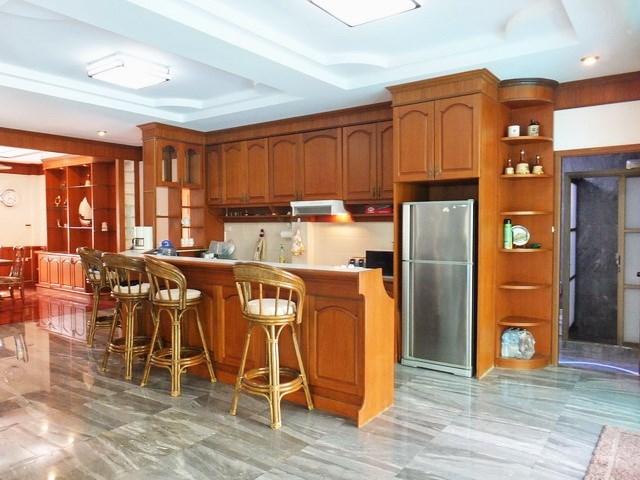 House for Sale Mabprachan Pattaya showing the kitchen and guest bathroom